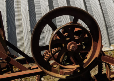 Cogs from a baler awaiting restoration