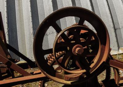 Cogs from a baler awaiting restoration